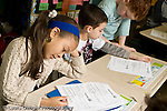 Education Elementary school Grade 2 children in class working on English language arts worksheets horizontal