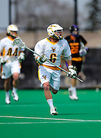 10 April 2011: University of Vermont Catamount LSM Max Gradinger, a Senior from Rancho Santa Fe, CA, in action against the University at Albany Great Danes on Moulton Winder Field in Burlington, Vermont. The Catamounts defeated the visiting Danes 11-6 in America East play. Mandatory Credit: Ed Wolfstein Photo