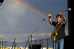 Will Kimbrough of the Rodney Crowell Band warms up with a rainbow at the Red Ants Pants Music Fest.