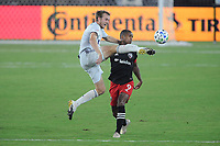 WASHINGTON, DC - AUGUST 25: Henry Kessler #4 of New England Revolution battles for the ball with Ola Kamara #9 of D.C. United during a game between New England Revolution and D.C. United at Audi Field on August 25, 2020 in Washington, DC.