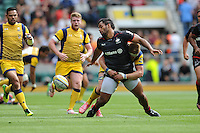 Billy Vunipola of Saracens loses the ball as he is tackled by GJ van Velze of Worcester Warriors during the Aviva Premiership Rugby match between Saracens and Worcester Warriors at Twickenham Stadium on Saturday 03 September 2016 (Photo by Rob Munro/Stewart Communications)