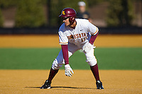Justin Gominsky #18 of the Minnesota Golden Gophers takes his lead off of first base against the Towson Tigers at Gene Hooks Field on February 26, 2011 in Winston-Salem, North Carolina.  The Gophers defeated the Tigers 6-4.  Photo by Brian Westerholt / Sports On Film