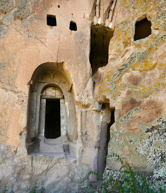 """Pictures & images of Komurlu Church interior,  9th century, the Vadisi Monastery Valley, """"Manastır Vadisi"""",  of the Ihlara Valley, Guzelyurt , Aksaray Province, Turkey.<br /> <br /> Kalburlu (St. Epthemios) church dates back to the 9th or 10th century. It is carved out of a single rock massive with rock columns holding up the roof of its church . The arches of Kalburlu (St. Epthemios) church have rich architectural decorated relif sculptures. The naves are connected by rounded arches & there is a baptismal font to the east of the main entrance."""
