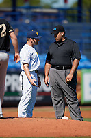 Michigan Wolverines head coach Erik Bakich (23) questions a call with umpire Kyle Reese during a game against Army West Point on February 18, 2018 at Tradition Field in St. Lucie, Florida.  Michigan defeated Army 7-3.  (Mike Janes/Four Seam Images)
