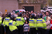 ATTENTION SPORTS PICTURE DESK<br /> Pictured: Swansea supporters taunt the arriving coaches with Cardiff supporters, guarded by heavy police presence.<br /> Re: Coca Cola Championship, Swansea City Football Club v Cardiff City FC at the Liberty Stadium, Swansea, south Wales. Saturday 07 November 2009