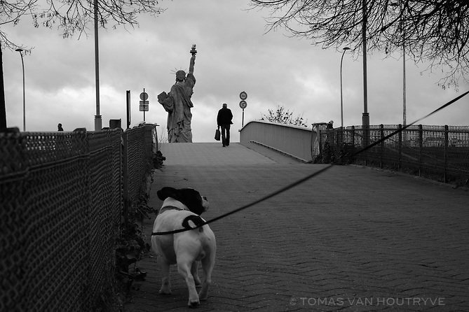 A replica of the Statue of Liberty is seen at the end of Allee des Cygnes in Paris, France, four days after coordinated terrorist attacks struck the heart of the French capital.