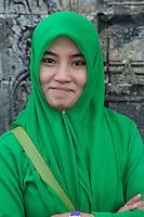 Borobudur, Java, Indonesia.  Young Woman from Surabaya Visiting the Temple.