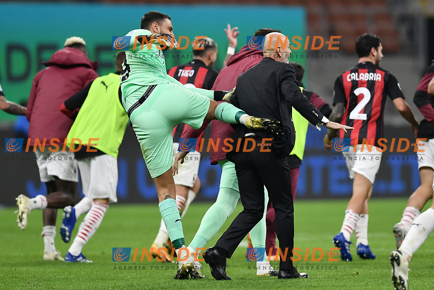 Gianluigi Donnarumma gives a kick to Stefano Pioli while they celebrate the victory at the end of the Serie A football match between FC Internazionale and AC Milan at stadio San Siro in Milano (Italy), October 17th, 2020. Photo Image Sport / Insidefoto