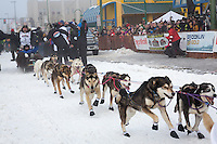 Scott Janssen and team leave the ceremonial start line at 4th Avenue and D street in downtown Anchorage during the 2013 Iditarod race. Photo by Jim R. Kohl/IditarodPhotos.com