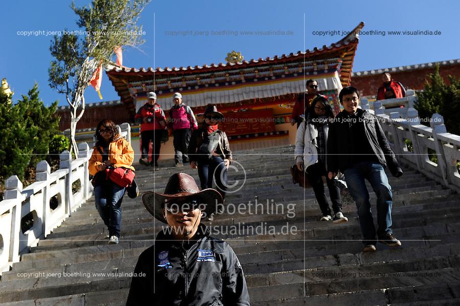 CHINA Province Yunnan Lugu Lake , ethnic minority Mosuo who are buddhist and women have a matriarch, buddhist temple on island in the Lake, chinese tourists / CHINA Provinz Yunnan , ethnische Minderheit Mosuo am Lugu See , die Mosuo sind Buddhisten und Mosuo Frauen ueben ein Matriarchat aus, buddhistische Pagode auf Insel im See