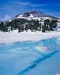Lassen Volcanic National Park, CA<br /> The shoreline of Lake Helen exposing the lake water from the spring melt of winter snows with Lassen Peak in the distance.