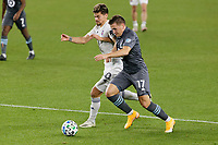 ST PAUL, MN - NOVEMBER 4: Gaston Gimenez #30 of Chicago Fire FC and Robin Lod #17 of Minnesota United FC battle for the ball during a game between Chicago Fire and Minnesota United FC at Allianz Field on November 4, 2020 in St Paul, Minnesota.