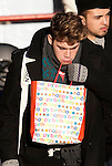 X Factor rehearsals .Fountain studios  9.12.10.Exclusive pic.- Grimshaw Birthday..X Factor finalist Aiden Grimshaw arrives for rehearsals carrying a (belated 4th December) birthday gift. But is does not appear to have cheered him up..Grim Birthday....pic by Gavin Rodgers/ Pixel 8000.07917221968