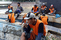 Government sanitation workers in central Jakarta, Indonesia.