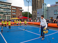 11-sept.-2013,Netherlands, Groningen,  Martini Plaza, Tennis, DavisCup Netherlands-Austria, Draw,   Street tennis on the market squire with Robin Haase (NED)<br /> Photo: Henk Koster
