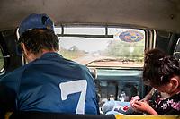 Passengers, travel in the back of a cab towards a Sunday market in Eterazama town, Chapare region, Bolivia. December 01, 2019.<br /> Les passagers, voyageant à l'arrière d'un taxi vers un marché dominical dans la ville d'Eterazama, région du Chapare, Bolivie. 01 décembre 2019.