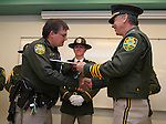 Carson City Sheriff Kenny Furlong, right, presents Deputy Matt Putzer with a life-saving award during a ceremony at the Carson City Sheriff's Office in Carson City, Nev., on Wednesday, April 24, 2013. .Photo by Cathleen Allison