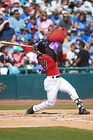 Matt Whatley (19) of the Hickory Crawdads follows through on his swing against the Charleston RiverDogs at L.P. Frans Stadium on May 13, 2019 in Hickory, North Carolina. The Crawdads defeated the RiverDogs 7-5. (Brian Westerholt/Four Seam Images)