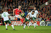 Jonathan Williams of Wales (2nd L) shoots the ball off target while closely marked by Glenn Whelan (L) and Cyrus Christie of Ireland (3rd L)during the FIFA World Cup Qualifier Group D match between Wales and Republic of Ireland at The Cardiff City Stadium, Wales, UK. Monday 09 October 2017