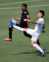 LOS ANGELES, CA - AUGUST 22: Cristian Pavon #10 of the Los Angeles Galaxy traps the ball during a game between Los Angeles Galaxy and Los Angeles FC at Banc of California Stadium on August 22, 2020 in Los Angeles, California.
