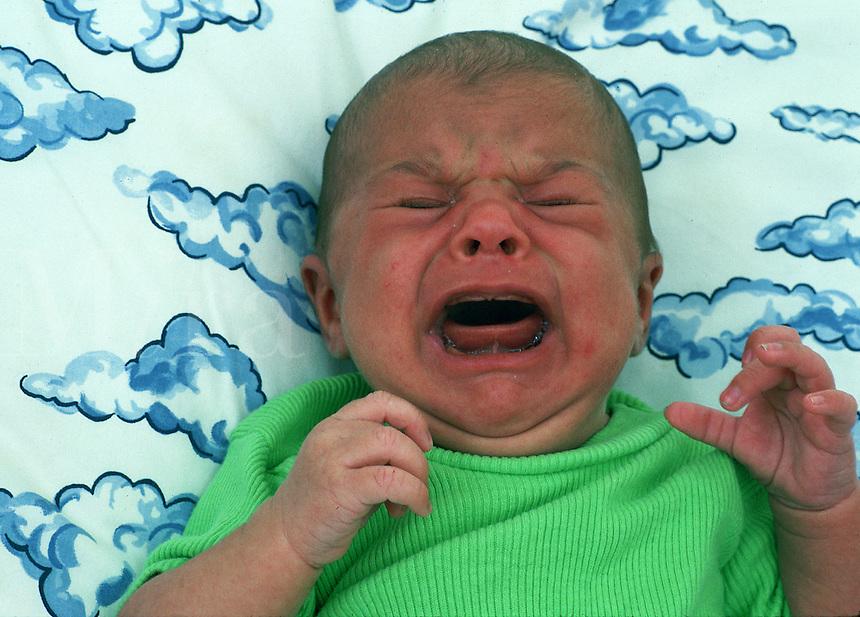 A newborn baby boy crying.