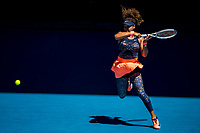 18th February 2021, Melbourne, Victoria, Australia; Naomi Osaka of Japan returns the ball during the semifinals of the 2021 Australian Open on February 18 2021, at Melbourne Park in Melbourne, Australia.