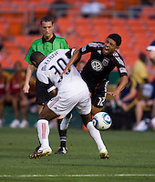 Christian Castillo (12) of D.C. United collides near the box with Rauwshan McKenzie (30) of Real Salt Lake during a U.S. Open Cup tournament game at RFK Stadium in Washington, DC.  D.C. United defeated Real Salt Lake, 2-1, in overtime.