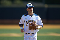 Mike Palladino (12) of the Quinnipiac Bobcats jogs off the field between innings of the game against the Radford Highlanders at David F. Couch Ballpark on March 4, 2017 in Winston-Salem, North Carolina. The Highlanders defeated the Bobcats 4-0. (Brian Westerholt/Four Seam Images)