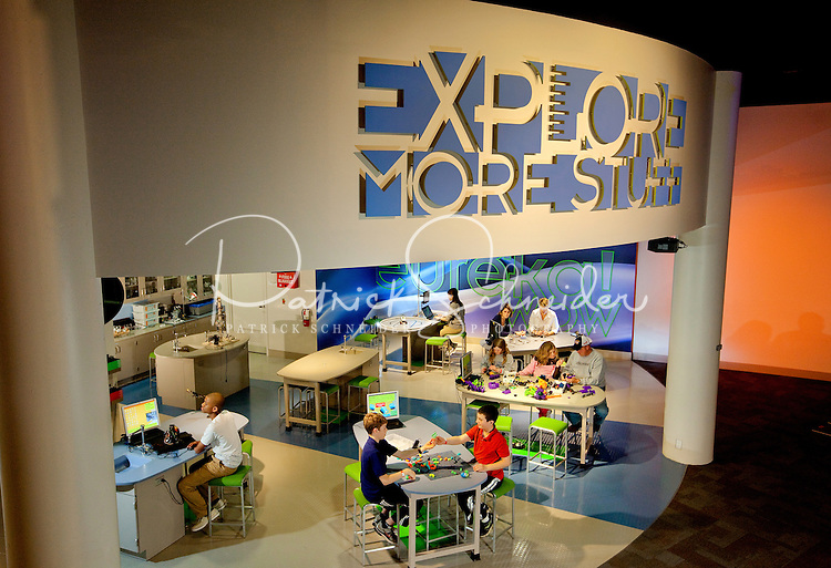 """Charlotte, NC on-location photography of Discovery Place, Charlotte's hands-on science museum located in downtown Charlotte NC. In this image, kids check out the """"Explore More Stuff Lab,"""" a lab-like environment where matter and energy are explored and tested."""