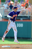 Second Baseman Steve Wilkerson #17 leaps to field a throw from the catcher during a  game against the Miami Hurricanes at Doug Kingsmore Stadium on March 31, 2012 in Clemson, South Carolina. The Tigers won the game 3-1. (Tony Farlow/Four Seam Images).