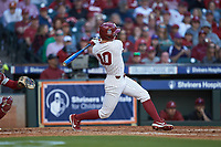 Tanner Tredaway (10) of the Oklahoma Sooners follows through on his swing against the Arkansas Razorbacks in game two of the 2020 Shriners Hospitals for Children College Classic at Minute Maid Park on February 28, 2020 in Houston, Texas. The Sooners defeated the Razorbacks 6-3. (Brian Westerholt/Four Seam Images)