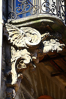 Paris Right Bank: A particular of the old decoration of a balcony (XVIII century) of rue Saint Antoine in the Marais.