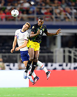 DALLAS, TX - JULY 25: James Sands #16 of the United States and Cory Burke #9 of Jamaica go up for a header during a game between Jamaica and USMNT at AT&T Stadium on July 25, 2021 in Dallas, Texas.