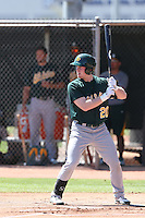 Billy McKinney #20 of the Oakland Athletics bats during a Minor League Spring Training Game against the Los Angeles Angels at the Los Angeles Angels Spring Training Complex on March 17, 2014 in Tempe, Arizona. (Larry Goren/Four Seam Images)