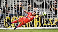 Orlando, FL - Saturday Jan. 21, 2017: São Paulo defender Junior (16) is at full extension to try to stop a penalty shot during the penalty kick shootout of the Florida Cup Championship match between São Paulo and Corinthians at Bright House Networks Stadium. The game ended 0-0 in regulation with São Paulo defeating Corinthians 4-3 on penalty kicks.