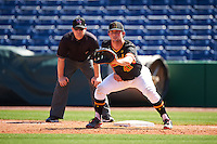 Maryland Terrapins first baseman Kevin Biondic (41) holds a runner on in front of umpire Sean Barber during a game against the Alabama State Hornets on February 19, 2017 at Spectrum Field in Clearwater, Florida.  Maryland defeated Alabama State 9-7.  (Mike Janes/Four Seam Images)