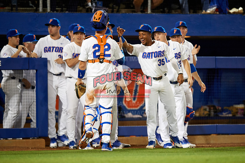 Florida Gators Andrew Baker (35) high fives catcher JJ Schwarz (22) during a game against the Siena Saints on February 16, 2018 at Alfred A. McKethan Stadium in Gainesville, Florida.  Florida defeated Siena 7-1.  (Mike Janes/Four Seam Images)