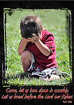 Insirational photo of a boy kneeling down in worship