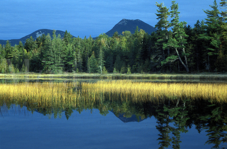 Doubletop Mountain reflecting in Elbow Pond, in Baxter State Park, Maine.