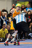16 MAR 2014 - BIRMINGHAM, GBR - Wizards of Aus jammer Rogue n Josh (left) tries to avoid being pushed off the track by Argentine blocker Diesel during the inaugural Men's Roller Derby World Cup at the Futsal Arena in Birmingham, West Midlands, Great Britain (PHOTO COPYRIGHT © 2014 NIGEL FARROW, ALL RIGHTS RESERVED)
