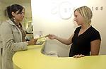 .Reception staff deals with customer.Photo Alan Edwards
