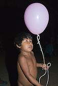 Mato Grosso State, Brazil. Aldeia Metuktire (Kayapo). Bepte with a balloon.