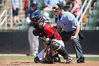 Kannapolis Intimidators catcher Nate Nolan (22) blocks a pitch in the dirt as home plate umpire Mike Snover looks on during the game against the Asheville Tourists at Kannapolis Intimidators Stadium on May 7, 2017 in Kannapolis, North Carolina.  The Tourists defeated the Intimidators 4-1.  (Brian Westerholt/Four Seam Images)