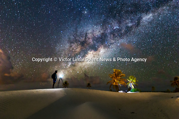 "Pictured: The night sky over Mangue Seco in Brazil.<br /> <br /> Photographs show incredible landscapes below a sky illuminated by stars. Away from cities and using long-exposure shots captures what cannot be seen with the naked eye of the night sky. <br /> <br /> The photos were taken across South America by landscape photographer Victor Lima. Mr Lima, 45, said: ""It is necessary to have a deep connection with nature to be able to understand a landscape you can't see with your own eyes."" SEE OUR COPY FOR ME DETAILS<br /> <br /> Please byline: Victor Lima/Solent News<br /> <br /> © Victor Lima/Solent News & Photo Agency<br /> UK +44 (0) 2380 458800"