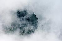 The precipitous slops of the Kaerazu no Ken appear through the cloud, briefly.