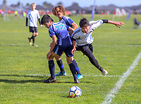 Ian Shin (Mount Maunganui Intermediate, right). Boys' football. 2019 AIMS games at Gordon Spratt Park in Papamoa, New Zealand on Thursday, 12 September 2019. Photo: Dave Lintott / lintottphoto.co.nz
