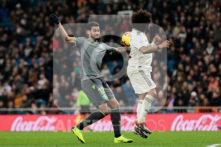 Real Madrid's Marcelo Vieira and Real Sociedad's Willian Jose Da Silva during La Liga match between Real Madrid and Real Sociedad at Santiago Bernabeu Stadium in Madrid, Spain. January 06, 2019. (ALTERPHOTOS/A. Perez Meca)<br />  (ALTERPHOTOS/A. Perez Meca)