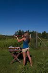 Young woman shooting a Marlin .22 rifle