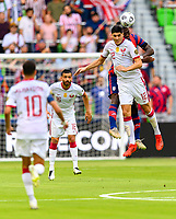 AUSTIN, TX - JULY 29: Daryl Dike #11 of the United States and Karim Boudiaf #12 of Qatar go up for a header during a game between Qatar and USMNT at Q2 Stadium on July 29, 2021 in Austin, Texas.