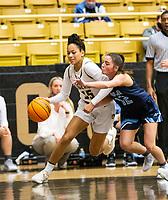 Jada Brown (35) of Bentonville drives to the basket with Maddux McCrackin (12) of Spring Har-ber defending  at Tiger Arena, Bentonville, AR January 5, 2021 / Special to NWA Democrat-Gazette/ David Beach